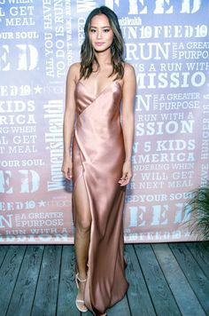 Jamie Chung wore a gorgeous maxidress while attending the Women's Health Magazine Party Under the Stars. Chung rocked the Silk Strappy Wrap Gown by Michelle Mason with a pair of white Stuart Weitzman Nudist heels. Find out how to copy her look for way less!