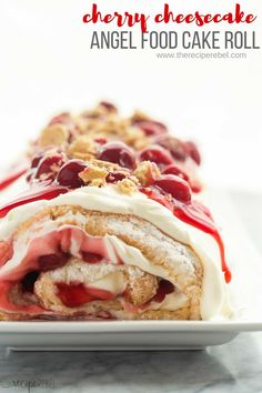 This Cherry Cheesecake Angel Food Cake Roll is the best kind of roll cake! It's made with light and fluffy angel food cake, and filled with a sweetened cream cheese whipped cream and cherry pie filling. It's the ULTIMATE summer dessert! Switch up the fruit to suit your tastes. Includes step by step RECIPE VIDEO #cherry #cherries #cheesecake #dessert #cakeroll #recipe #recipes