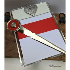 "The heart theme letter opener features a round red enamel setting and in the center a silver heart.   This letter opener is individually boxed in a shiny black gift box. The dimensions are 7.25"" x 1.5"".   Our notepad is acrylic and is embellish with the large hammered silver heart.  The paper is wrapped with red grosgrain ribbon.   The perfect combo for Valentine's Day, weddings, or any special occasion. Gifts For Wine Lovers, Wine Gifts, Wine Making Process, Room For Improvement, Black Gift Boxes, Fun Hobbies, Hammered Silver, Wine Tasting, Valentine Gifts"