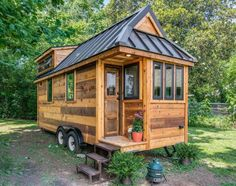 Farmhouse Chic: The Cedar Mountain Tiny House, built by Nashville-based New Frontier Tiny Homes, might look small on the outside, but inside, it's big on farmhouse-style design. Click through to discover more impressive tiny homes. Plan Tiny House, Tiny House Exterior, Best Tiny House, Tiny House Cabin, Tiny House On Wheels, Micro House, Tiny House Trailer, Car Trailer, Tiny Cabins
