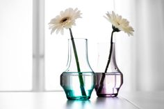 Brighten Mom's day everyday by leaving single fresh flowers from the garden by her bedside in these small vases. OLIK $1.99.