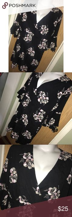 """Floral faux wrap bell sleeve dress Gorgeous floral faux wrap dress with bell sleeves. Elastic waist. 27"""" from armpit to armpit, 41"""" total length. Cato Dresses"""
