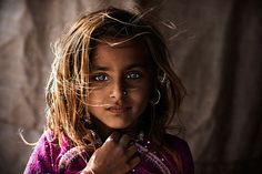 India-- I think this beautiful girl beats the Afghan lady on the cover of National Geographic for prettiest eyes.