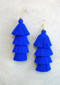 These are a hand-crafted pair of earrings that have been made from cotton yarn and gold beads. They will look great with your favorite pairs of jeans, shorts or a night out dress! Length 4.5