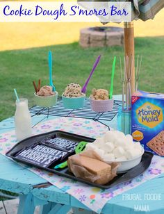 Change up those usual s'mores and offer your guests a fun and fuss-free Cookie Dough S'mores Bar instead- 3 edible, egg-free cookie dough spreads & a fun cookie baking inspired display.