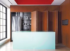 Image result for hiding a kitchen with folding panels