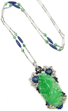 French enamel, platinum, lapis and jade pendant and chain necklace. S.J. Phillips Ltd