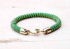 Best DIY Ideas Jewelry:    Manchettes, BRACELET _BADRA_GREEN & GOLD est une création orginale de luisekeller sur DaWanda    -Read More –