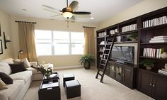 Library / den / study decor ideas - bookshelves with ladder and TV cabinet #glhomes #newfloridahomes