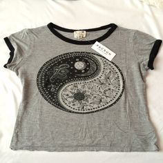 NWT pacsun grey ringer tee NWT Pacsun / LA Hearts soft light gray ringer tee with black rims on the neck and sleeves and an Aztec like ying yang sign. Size small. Never worn and in great condition. Ask for try on pics or bundles. PacSun Tops Tees - Short Sleeve