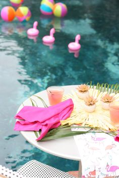 Pink flamingo pool party... I also set up a few cocktail tables around the pool for extra seating.