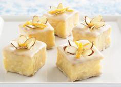 Apricot Petits Fours    Bite-sized citrus cakes are drizzled with a sweet apricot icing then topped with sliced almonds and orange peel.