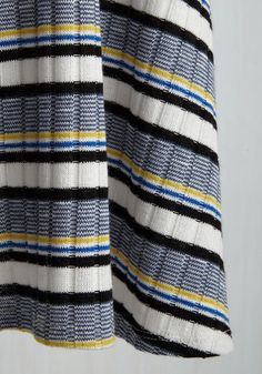 Sure, this knit dress from our ModCloth namesake label is stunning at a distance, but its fine details make it even more alluring. Looking more closely at the black, white, blue, and yellow stripes, along with its flirty back keyhole, this ribbed frock shows it means business when it comes to cozy styling!