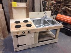 Pallet Mud Kitchen with Sink | 99 Pallets. Use galvanized tub for sink instead