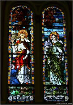 ST. ELIZABETH OF HUNGARY & ST. JADWIGA ŚLASKA, Chicago St. Adalbert Church - January 1, 2014. By Franz Xavier Zettler (German, 1841-1916), Royal Bavarian Stained Glass Manufactory, Munich, 1912-1914.Franz Xavier Zettler of the Royal Bavarian Stained Glass Manufactory (Munich), 1912-1914. St. Jadwiga (or Hedwig) was the aunt of St. Elizabeth of Hungary.