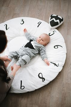 Beautiful monochrome milestone play mat for your baby nordic nursery. Great way to track your growing baby by taking pictures or use it as a baby gym activity playmat for a nursery. Suitable as a gift for babyshower of visiting newborn baby.  #milestone #monochromnursrey #babygift #playmat