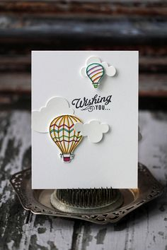 Birthday pop-up card with clouds and hot air balloons.