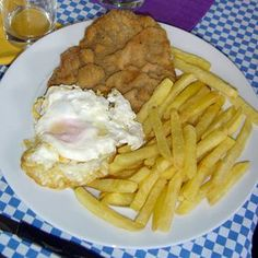 "Milanesa with true french fries and one fried egg. It is called ""milanesa a medio caballo"" (milanesa half horse)."