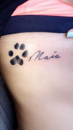 Tattoo on my ribs/side of my dog Maia's paw print and her name