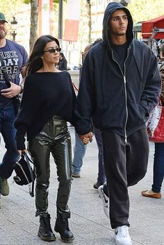 Kourtney Kardashian wearing Acne Studios Tugi Vinyl Pants and Dr. Martens 1460 Black Boots