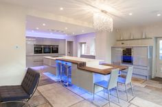 ATLANTIS KITCHENS PROJECT: Handleless Gloss Grey Kitchen - Dekton worktops - Spekva breakfast bar - Quooker boiling water tap - Siemens appliances - LED feature lighting - Glass splashbacks - Mirrored plinths to create floating effect