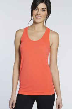 Fit: Semi-Fitted  Length: Hip  Built-In Bra: No  Fabric Content: 97% Nylon/3% Spandex  Features: Seamless, Chafe-Resistant Design, Ultra-Light and Breathable, Four-Way Stretch