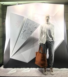 "ERMENEGILDO ZEGNA, London, UK, ""How to make a paper airplane: Fold first corner down on... "" photo by Window Shoppings, pinned by Ton van der Veer"