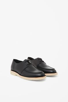 A modern interpretation of a classic deck style shoe, these shoes are made from smooth, raw-cut leather. They are completed with lightly cushioned insole and chunky crepe rubber sole.