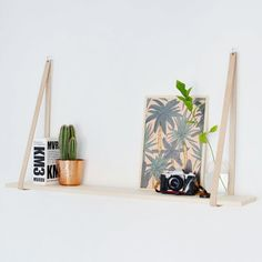Use leather straps to create this scandi inspired hanging shelf in minutes!