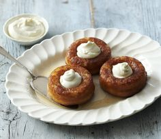 Rum babas are a boozy, retro pudding served with Chantilly cream