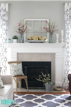Hi friends! It's that time again!! My mantel isall decked out for spring in farmhouse, fresh florals. All of the Christmas and winter decor has been (finally) put up in the attic. I always have a few stragglers that I miss the first time I put it all