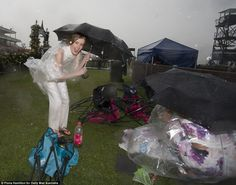 Scenes of mayhem: Chairs toppled over as racegoers used umbrellas to battle against the wild conditions Melbourne Races, Melbourne Cup, Oaks Day, Wild Weather, Umbrellas, Ladies Day, Battle, Chairs, Painting