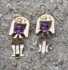These unique earrings are made from a pull tab (pop top) and upcycled clip earring backs.