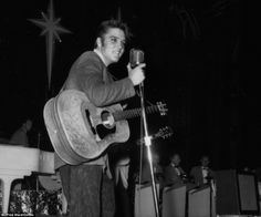 A legend was born: Elvis sings onstage during his first tour, summer 1956, with his signature leather overlay on his acoustic guitar