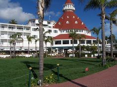 The Del Coronado Hotel in San Diego.  There is a room that is purported to be haunted and is very popular for guests to request to stay there.