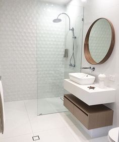 White wall mount vanity with timber under vanity cupboard. white square basin, chrome tap and mixer, chrome shower head, timber framed round mirror. Project by - @tiling_chronicles #taps #interiordesign #bathroom #australia #architecture #bathroomdesign #bathroomcollective Visit our website for more www.bathroomcollective.com.au