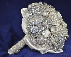If I were planning a wedding, I would carry this! Lasts longer than flowers :)  Blue Petyl – Bling Brooch Bouquet