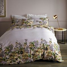 Infuse your bedroom with the jewel-toned florals of this Garden Gem duvet cover from Ted Baker. In rich golden and green shades, this duvet cover is edged with an intricate floral design on a fresh wh