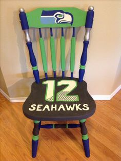 So if you are a 12th Man of Seattle Seahawks, you are gonna love this chair I painted yesterday! This chair was originally oak finish.  I was about to paint it white when all of a sudden I thought of something unique and special!  To turn it into a Seahawks 12th man chair!  My husband is a HUGE fan and he is my inspiration with this one :-) Everything here is hand painted without the help of stencils!