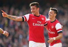 Olivier Giroud of Arsenal celebrates with teammate Mesut Oezil after scoring his team's fourth goal during the FA Cup Quarter-Final match between Arsenal and Everton at Emirates Stadium on March 8, 2014 in London, England
