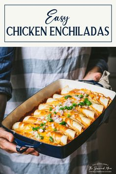 Easy chicken enchiladas are a perfect weeknight dinner! Stuffed with cheese, pulled chicken, black beans and corn, smothered in a zesty red sauce, and baked until warm and crisp, the Mexican-inspired dish is delicious alongside tortilla chips, salsa, guacamole and rice. Add your favorite toppings and enjoy the best chicken enchilada recipe ever -- with minimal effort!