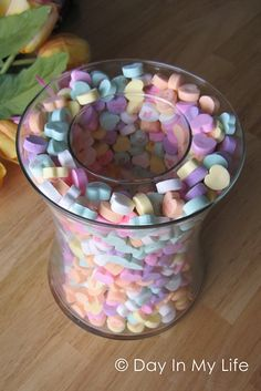 Take two different size vases and sprinkle candy hearts between for a centerpiece. (Other holidays too: marbles, colored m, Corks, etc) Save these and reuse each year.