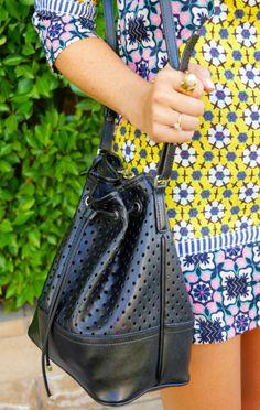 Kat Golden pairs the Banana Republic Dalia Bucket Bag with a graphic mini.