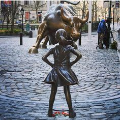 """The statue """"Fearless Girl"""" created by Kristen Visbal makes a statement about how underrepresented women are on Wall Street. #ellevietnam #ellevn #fearlessgirl #kristenvisbal #wallstreet #women #girl #cute #beautiful #art #photooftheday  via ELLE VIETNAM MAGAZINE OFFICIAL INSTAGRAM - Fashion Campaigns  Haute Couture  Advertising  Editorial Photography  Magazine Cover Designs  Supermodels  Runway Models"""