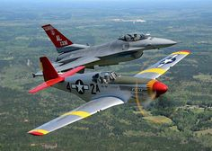 """The CAF Red Tail Squadron """"Tuskegee Airmen"""" P-51C and a red-tailedu F-16 from the Alabama Air National Guard 100th Fighter Squadron fly in formation over Moton Field, the former home for Tuskegee Airmen training, and now the Tuskegee Airmen National Historic Site"""