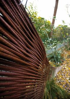 Composting Shed in Edinburg with Rusted Fence | Gardenista
