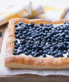 It doesn't get easier than this. By using frozen puff pastry, you can bake and assemble this delicious tart in under an hour. Guests will like that this tart isn't too decadent with the cream cheese-and-lemon filling and fresh blueberries on top.