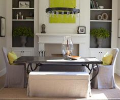 Love the chairs, chandelier, painted inside of shelving, and pops of color with pillows and artwork.  Fixture similar to Robert Abbey Rico chandelier or Ralph Lauren Roark chandelier.