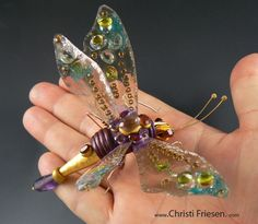one of my latest - bug using polymer, jewelry findings, sheet mica, resin, epoxy clay and gemstones #christifriesen #polymer #artnouveau #bug #insectart #gemstones