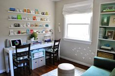 Office slash playroom...how to coexist. Love the rows of frame ledges